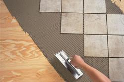 Выравнивание поверхности перед укладкой плитки